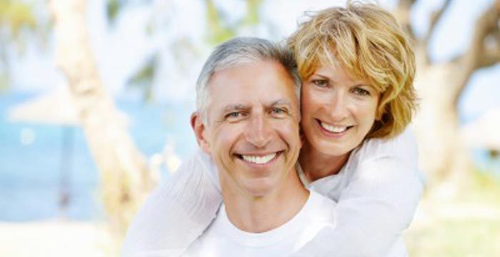 couple with tooth replacement